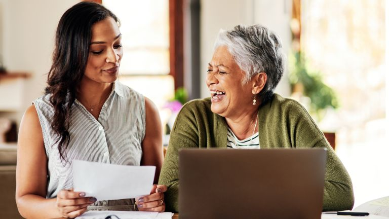 A tax preparer discusses retirement options with her granddaughter